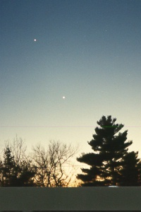 The Conjunction of Venus and Jupiter - Feb 15, 1999 - Photo Copyright by Ron and Jean Zincone